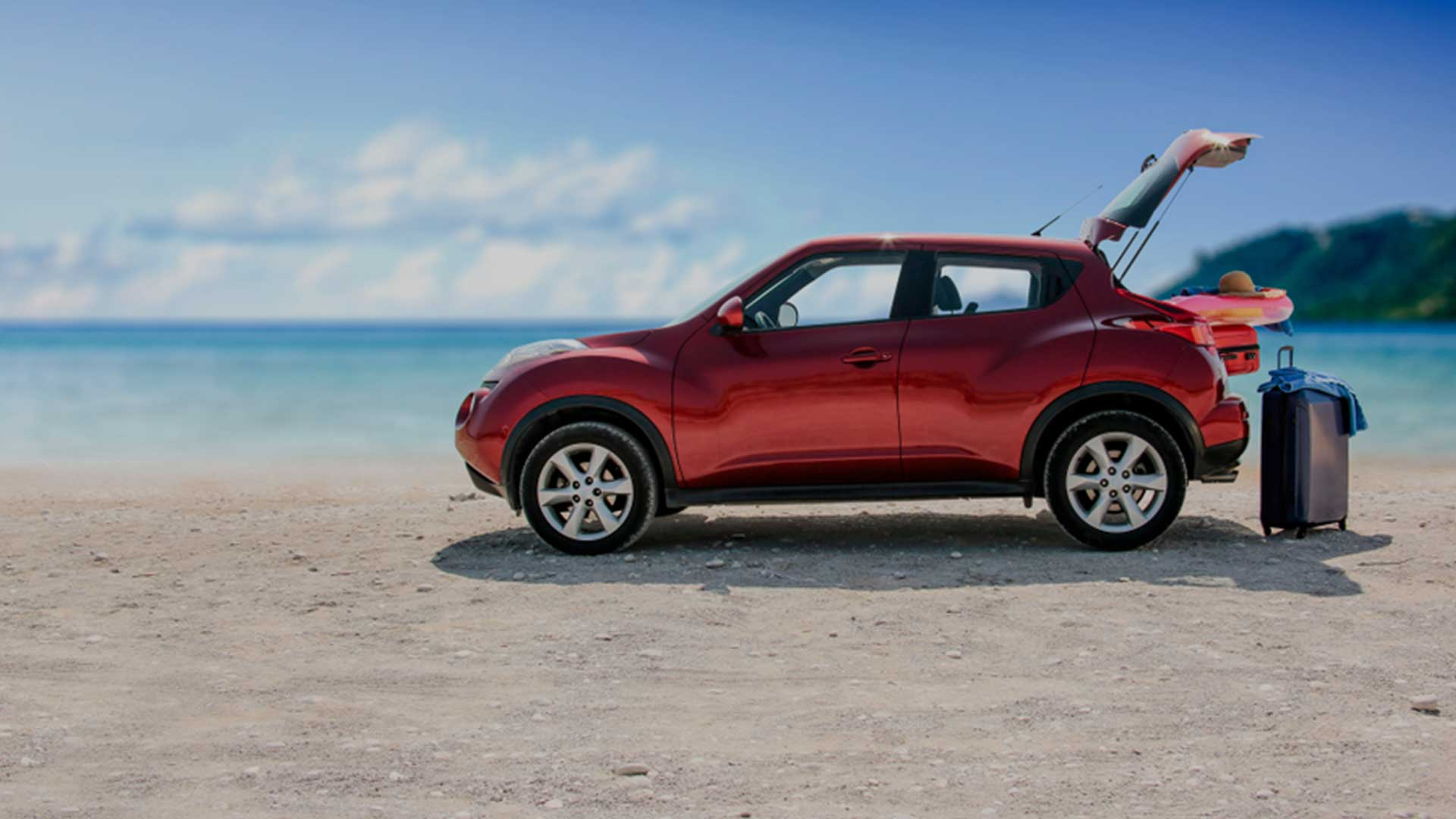 red suv car on the beach
