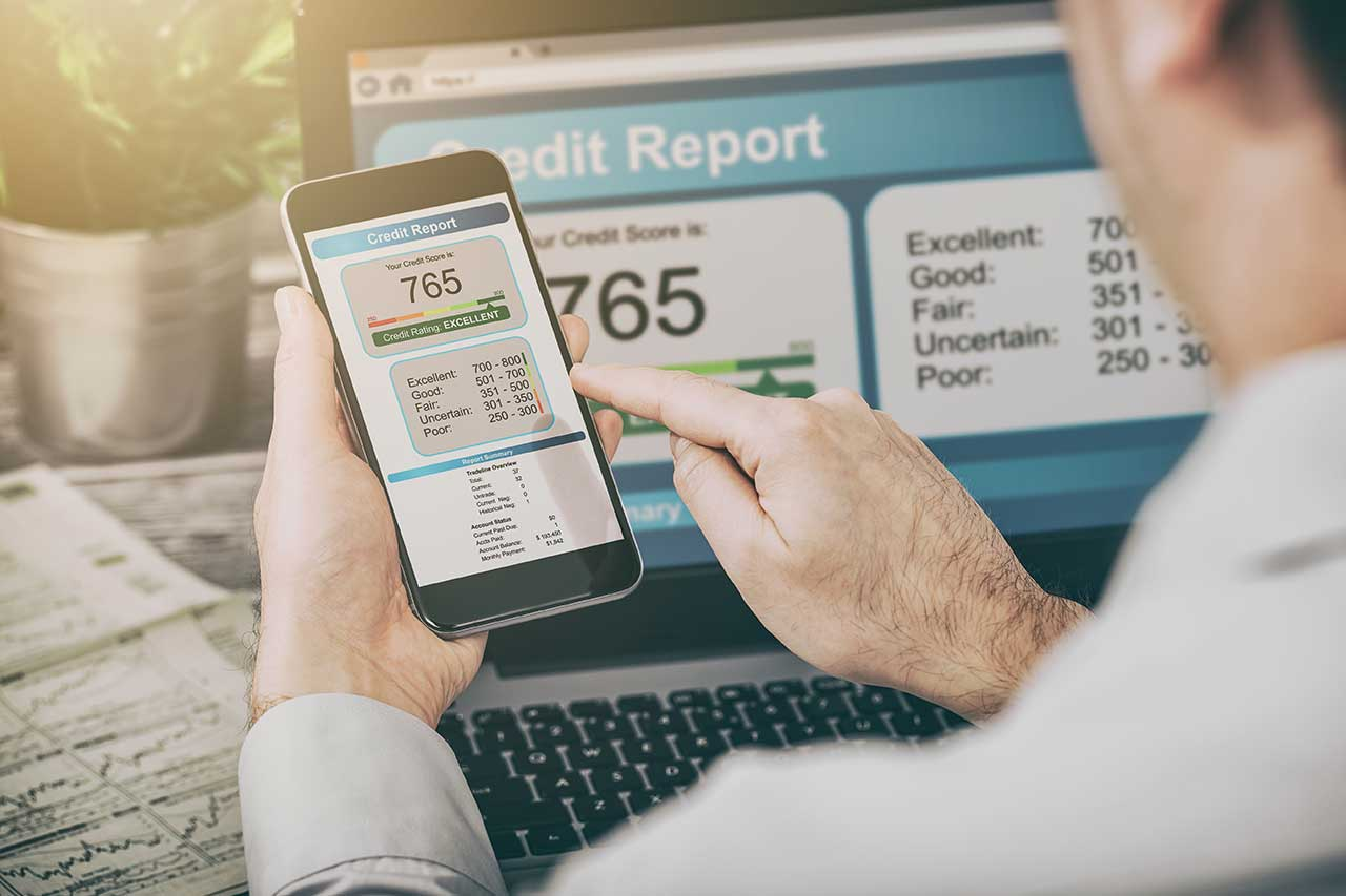 Man is checking his credit report online - Image